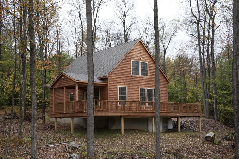 24' x 36' Custom Tioga with side porch and large deck