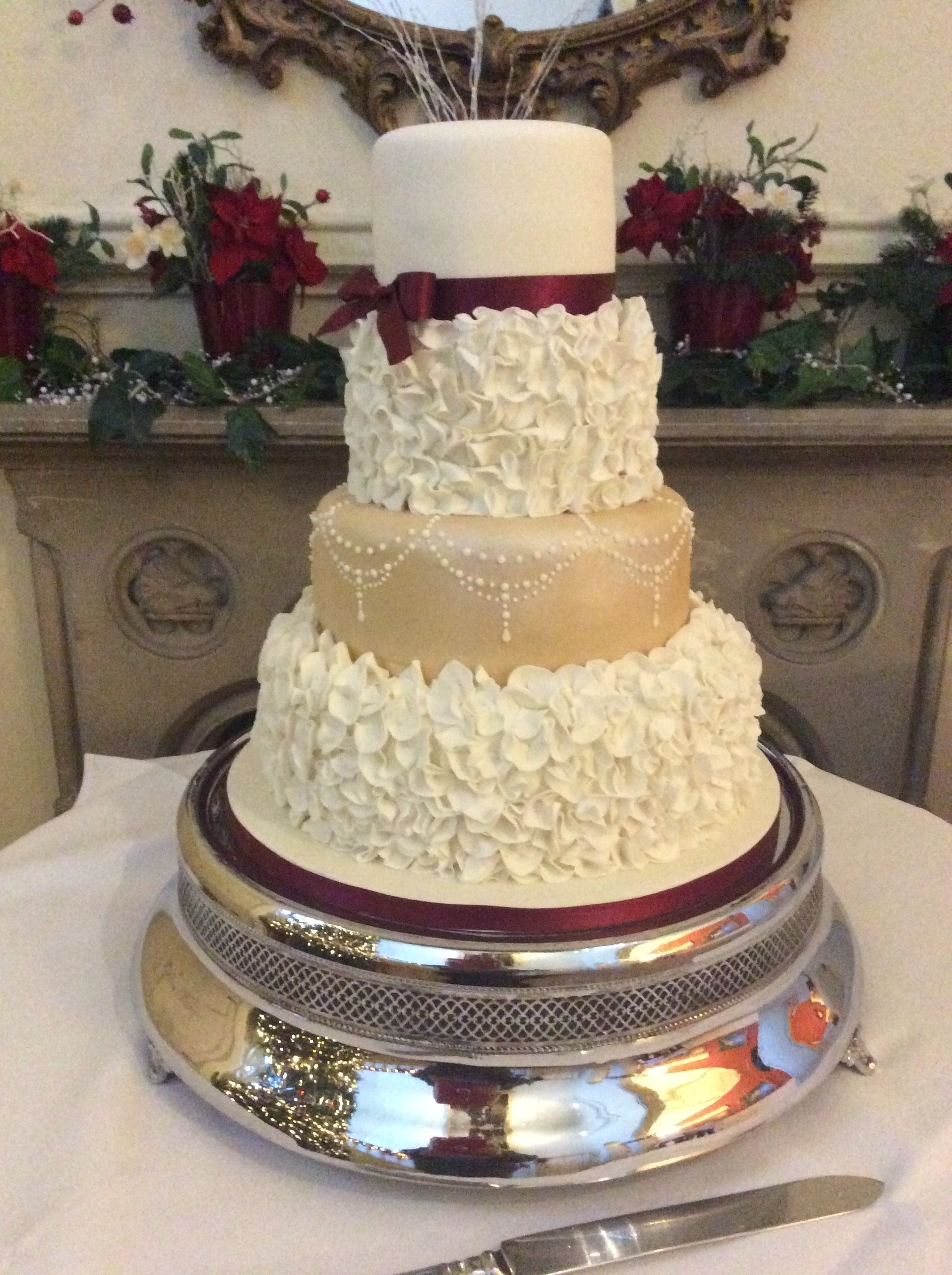 Ruffles December Wedding Cake In Ivory Pale Gold And Burgundy With