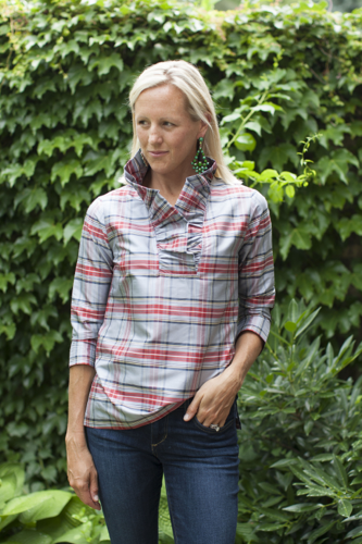 """Our Signature Ruffle Collar style has arrived in this Classic and timeless Tartan Plaid! This style features a dramatic 3"""" stand up ruffle collar, 3/4 length sleeve and side vents at the hem, which add comfort and ease through the hip. We've added a rich chocolate suede patch to the elbow. We love to style this piece tucked in or worn as a relaxed tunic. *Fitted through the bust, relaxed waist and hip."""