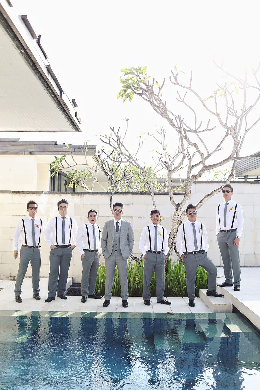 Groomsmen in grey and suspenders // Ronald and Evelyn's Colourful Wedding With Chinoiserie Touches