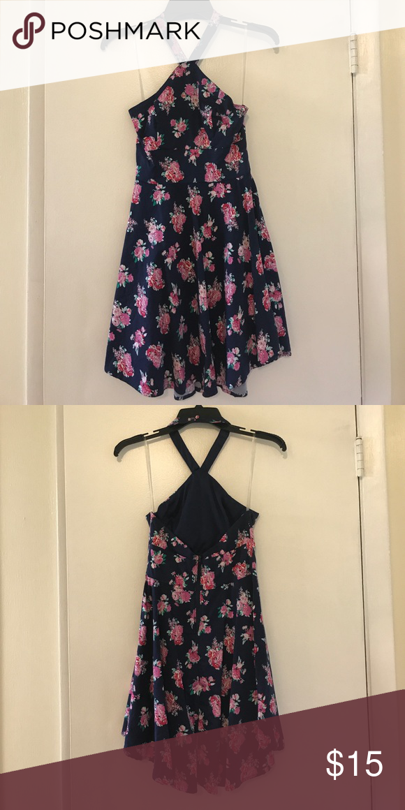 Charlotte Russe floral skater dress. Size M Navy floral print skater dress. Halter top. Size M. Very stretchy material. Perfect dress for summer. Worn once. Excellent condition! Charlotte Russe Dresses