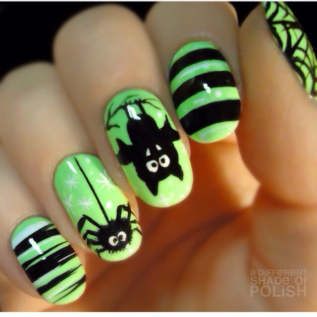 Green and Black Halloween Nail Design. Black bat and spider stripped ...
