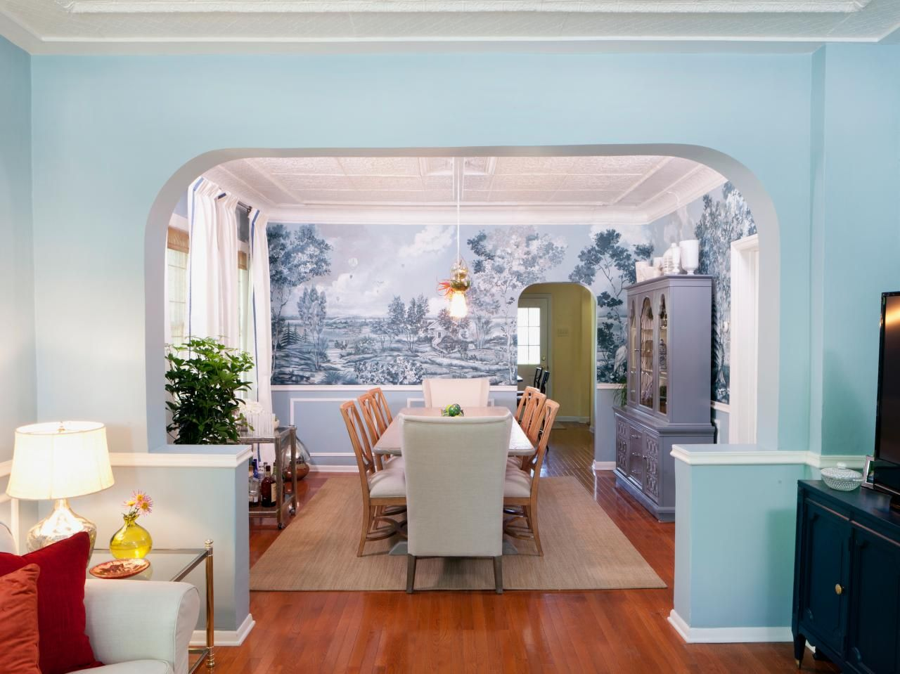 A Light Blue Entryway Leads From The Living Room Into A Traditional Dining Room With Long Neutral Dining Green Dining Room Eclectic Dining Room White Paneling