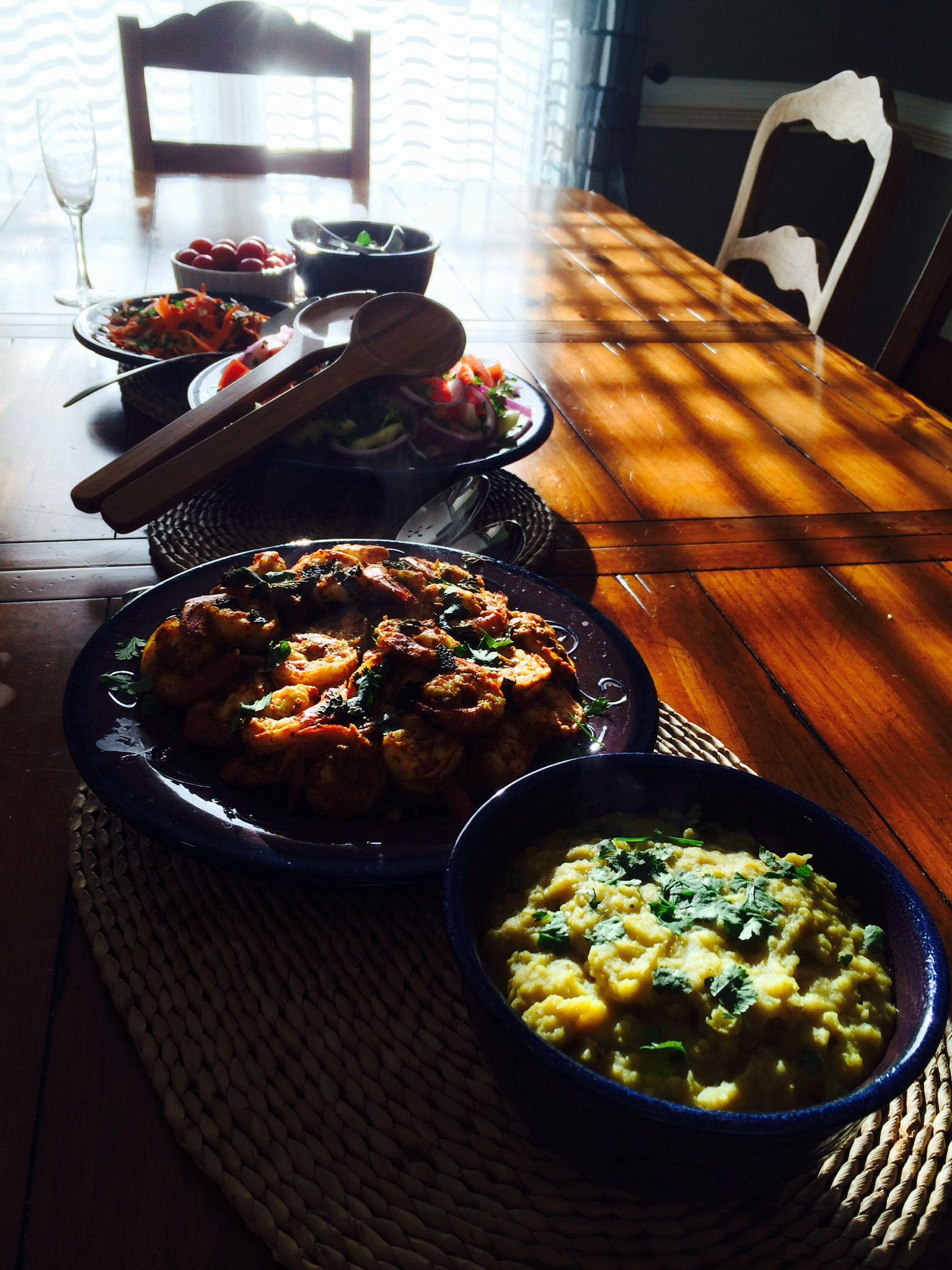 Masala prawns, lentil Dhal, and salad accompaniments