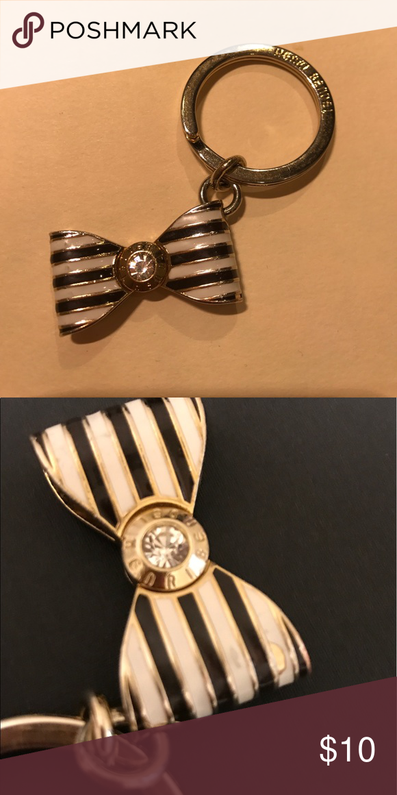 Henri Bendel Charm Super cute bow charm with ring to attach to any keychain or purse- a little worn but still cute. A small piece of paint missing and wear and tear small scratches but hardly noticeable unless look close. henri bendel Accessories Key & Card Holders