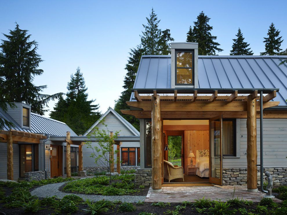 log cabin metal roof exterior rustic with tree trunk