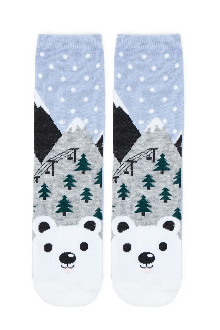 A pair of knit crew socks featuring a polar bear and snow print, contrast heel, and ribbed trim.