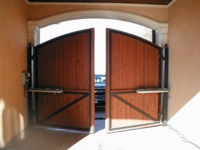 Swing Door This Gate Is Used As The Garage Door It Has A Steel Frame And Cedar Overlay Motorized With Liftmaster Gate Actu Garage Doors House Home Projects