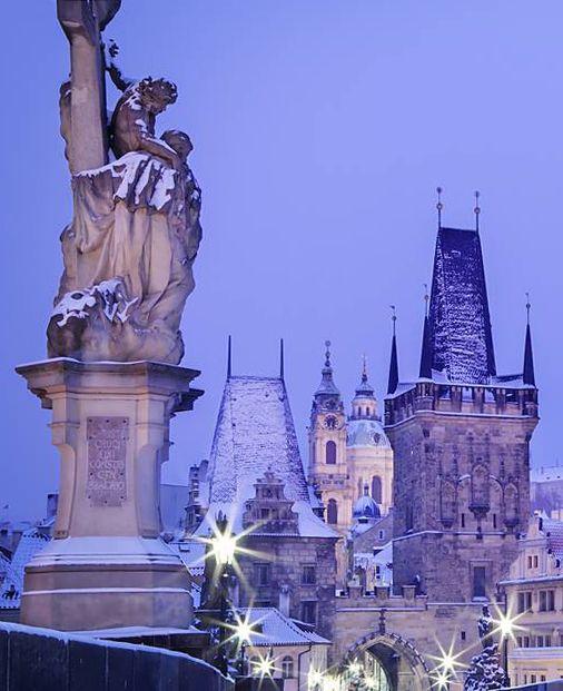 Prague in winter, Czechia (Mostecká tower and Saint Nicolas church at Lesser Town)