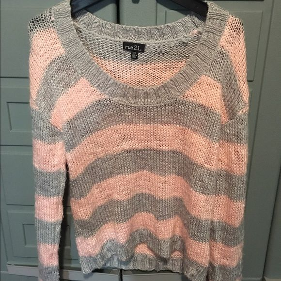 Rue 21 pink and gray pullover sweater. This is a Rue 21 pink and gray pullover sweater. It is a size small. Rue 21 Sweaters Shrugs & Ponchos