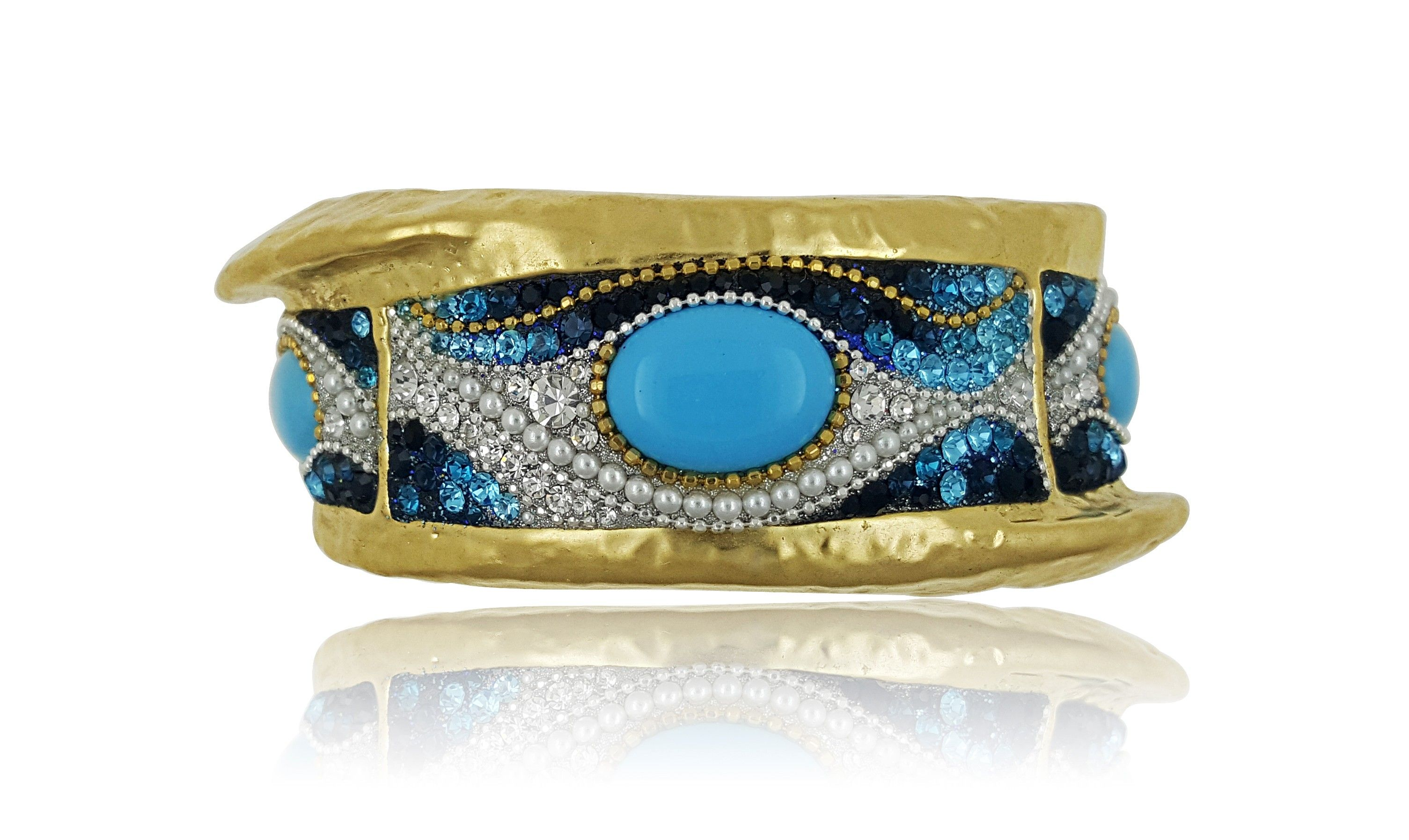07d85cc5d710 Get ready to make an entrance with this eye-catching blue and gold hammered  bangle