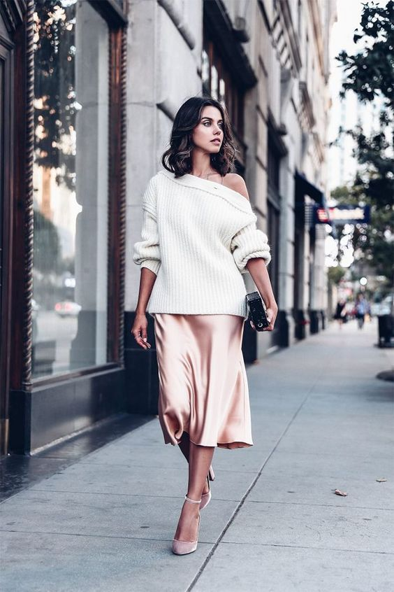 a pink midi skirt, a white off the shoulder slouchy sweater, pink velvet shoes with ankle straps