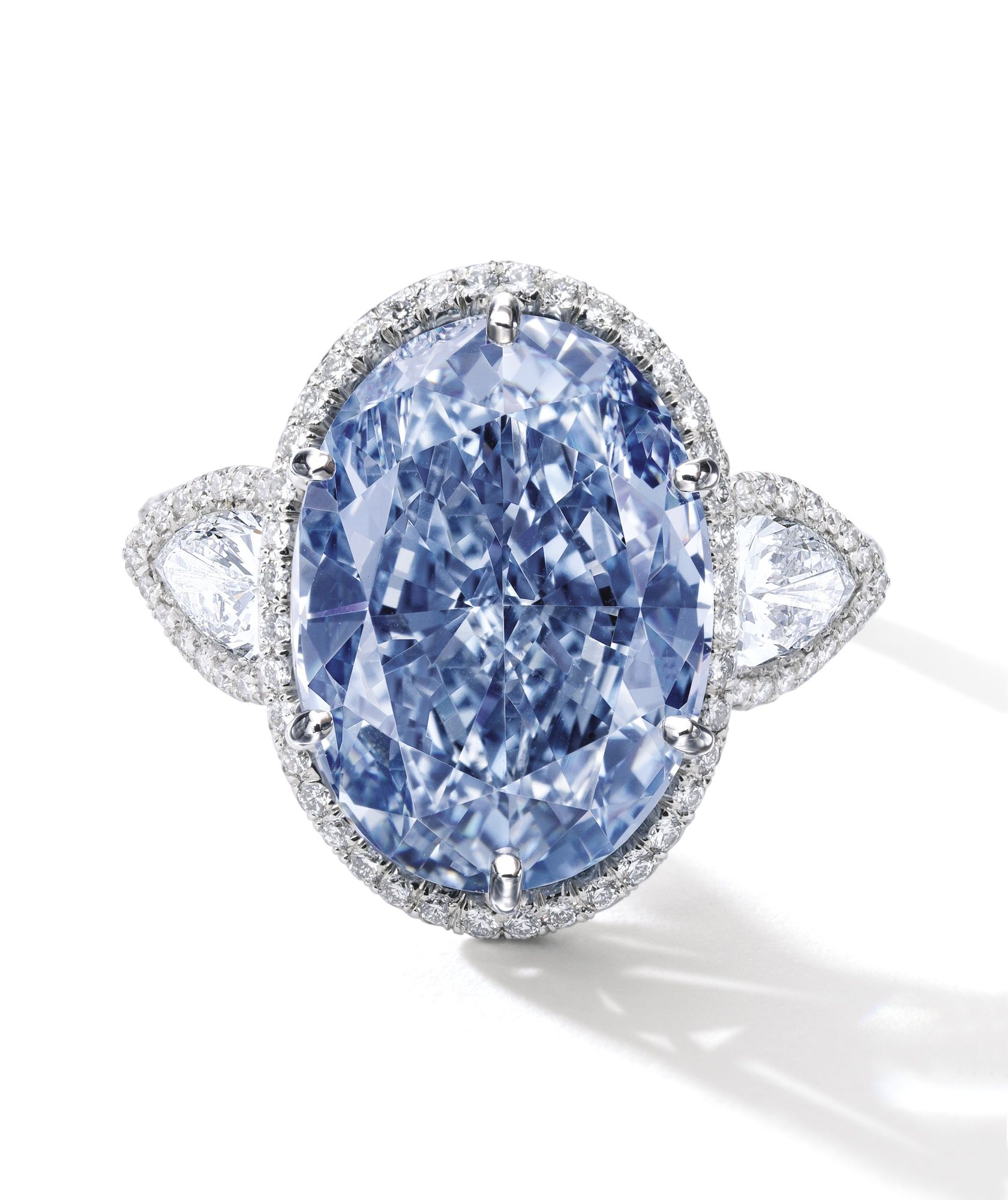 Superb and Rare Fancy Vivid Blue Diamond and Diamond Ring Set with
