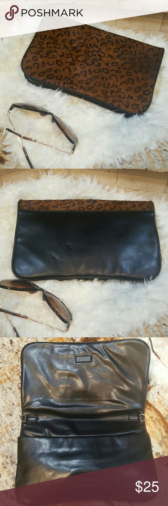 LOFT Leather Clutch Pre-owned black leather/leopard calf hair Ann Taylor Loft Clutch!  This is a great little clutch!  Exterior features super soft leather, and leopard print calf hair.  Interior has a zipper to secure belongings from falling out.  No flaws of mention.  Chain is missing. LOFT Bags Clutches & Wristlets