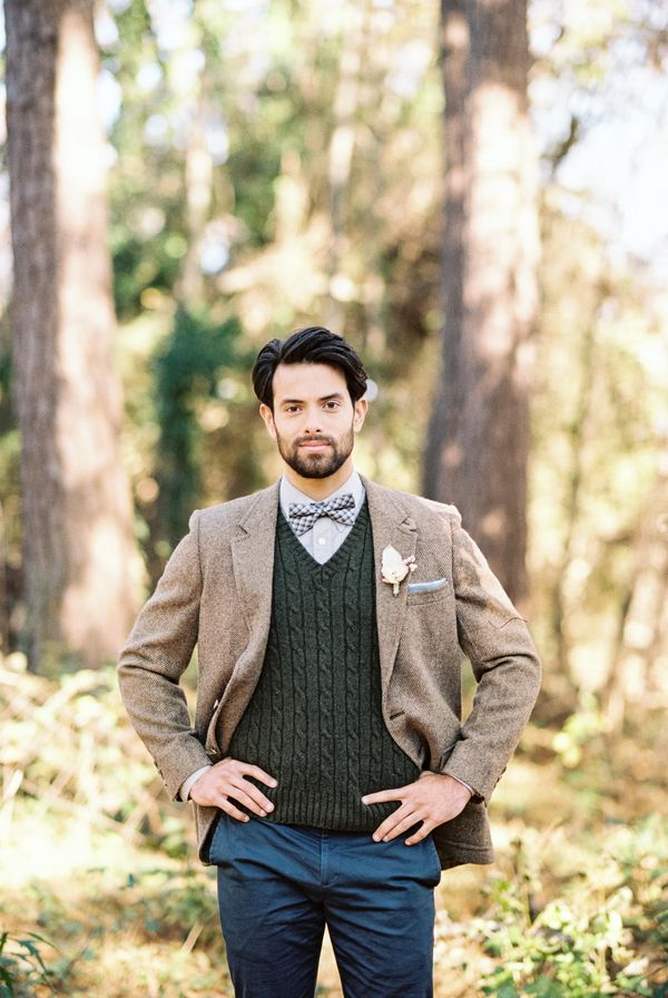 The groom looked stylish in a deep hunter green sweater vest, navy ...