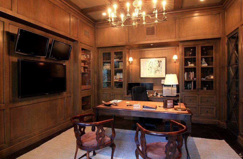 The Office features dark hardwood floors, rich wood