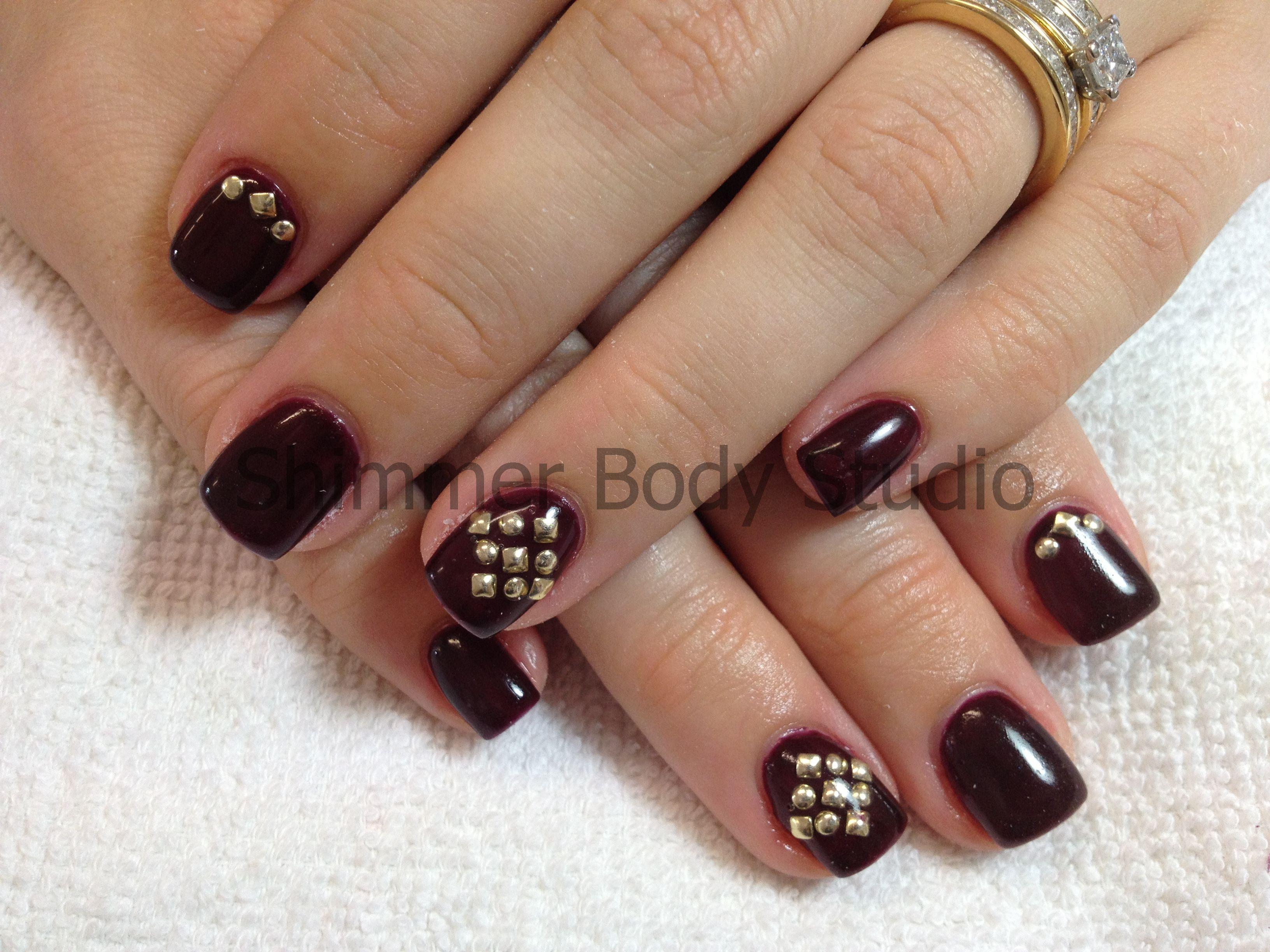 Gel nails, short square nails, burgandy port nails, gold studs nail ...