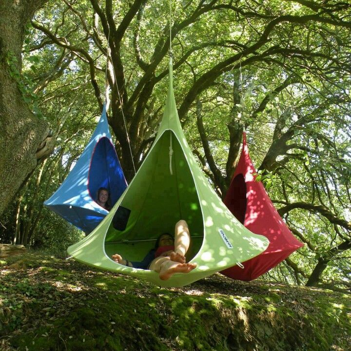 Could make an outdoor hangout area amongst trees - these are suspended tents but we could use more traditional hammocks & Could make an outdoor hangout area amongst trees - these are ...
