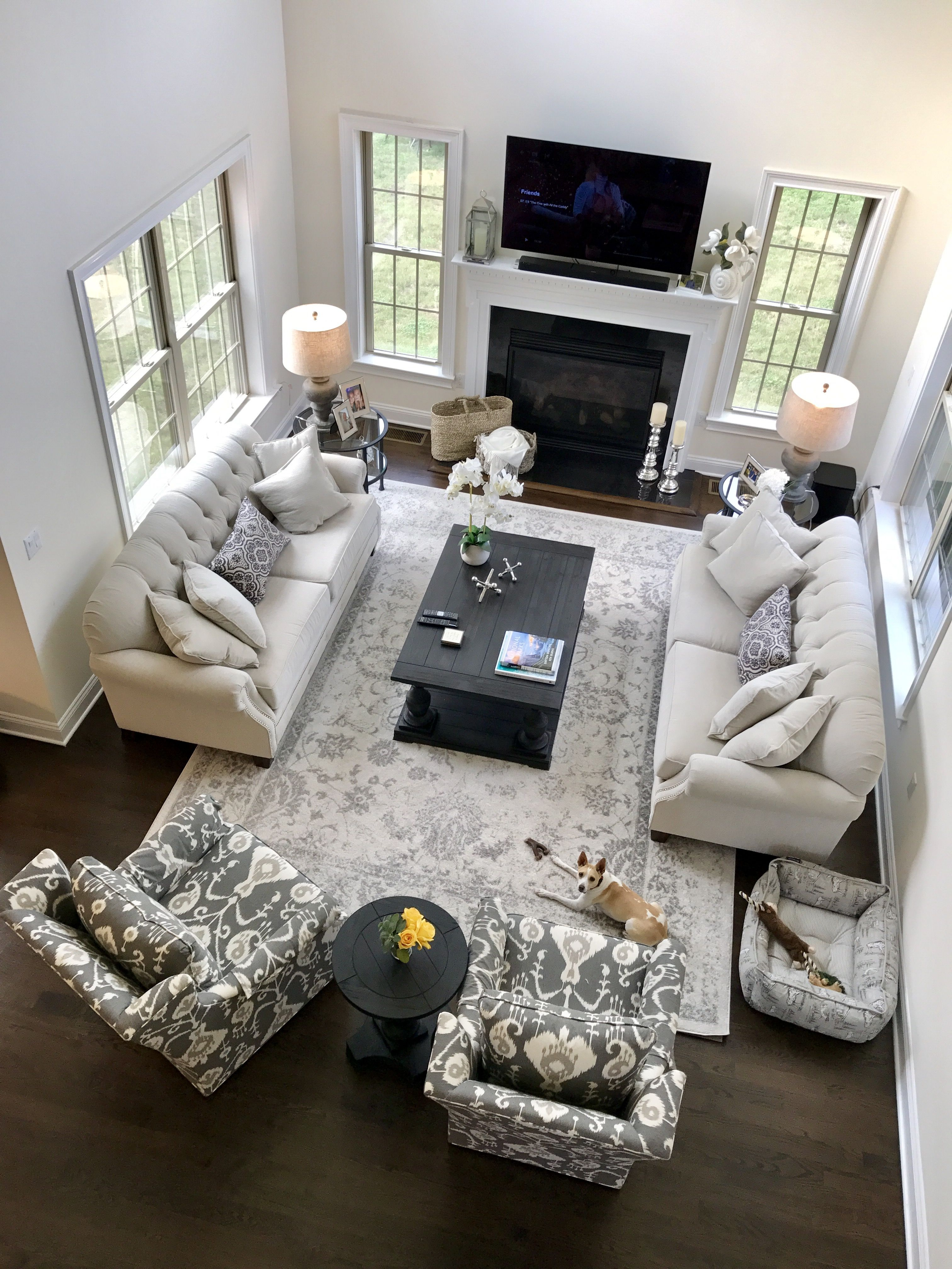 Cozy neutral living room open concept grey and cream transitional and casual decorating with - Open concept living room furniture placement ...