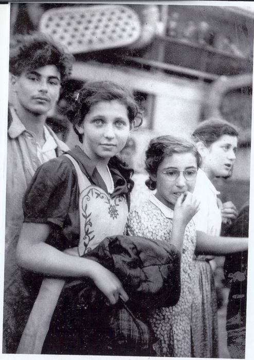 Holocaust survivors from the illegal immigrant ship Exodus . . . Can't help but notice the girl facing the camera and the hope in her eyes .