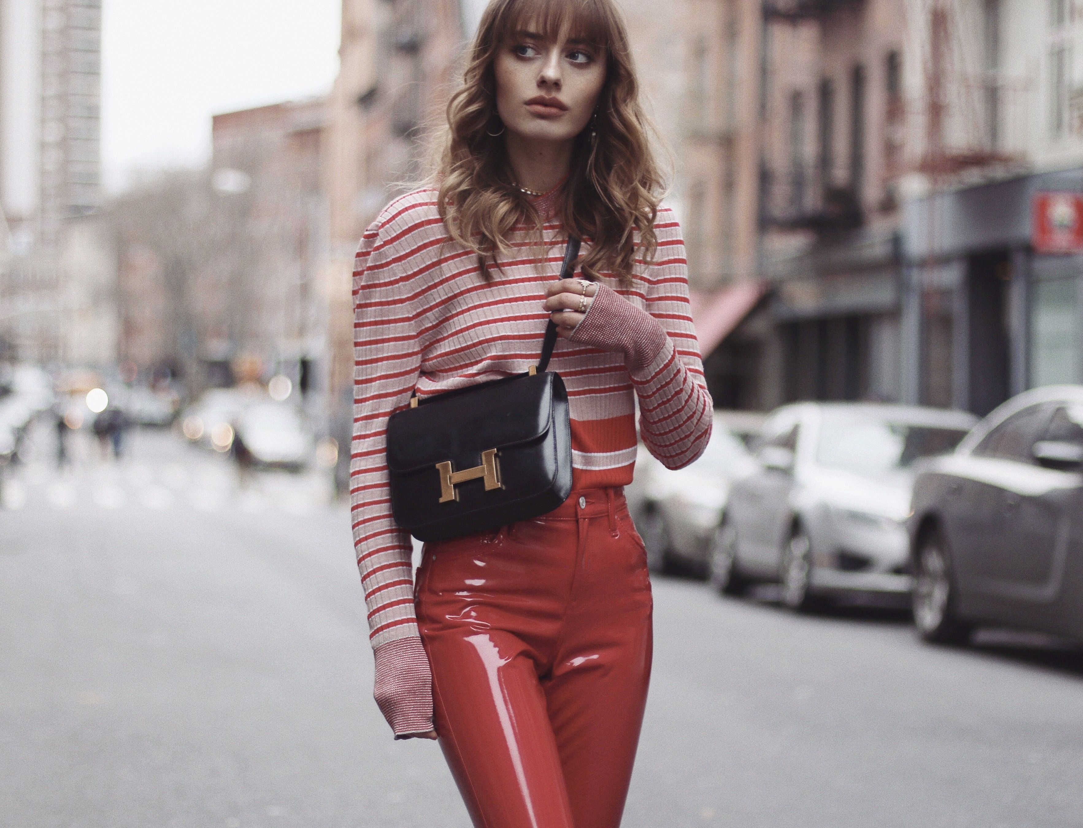 the lady in red… vinyl pants.