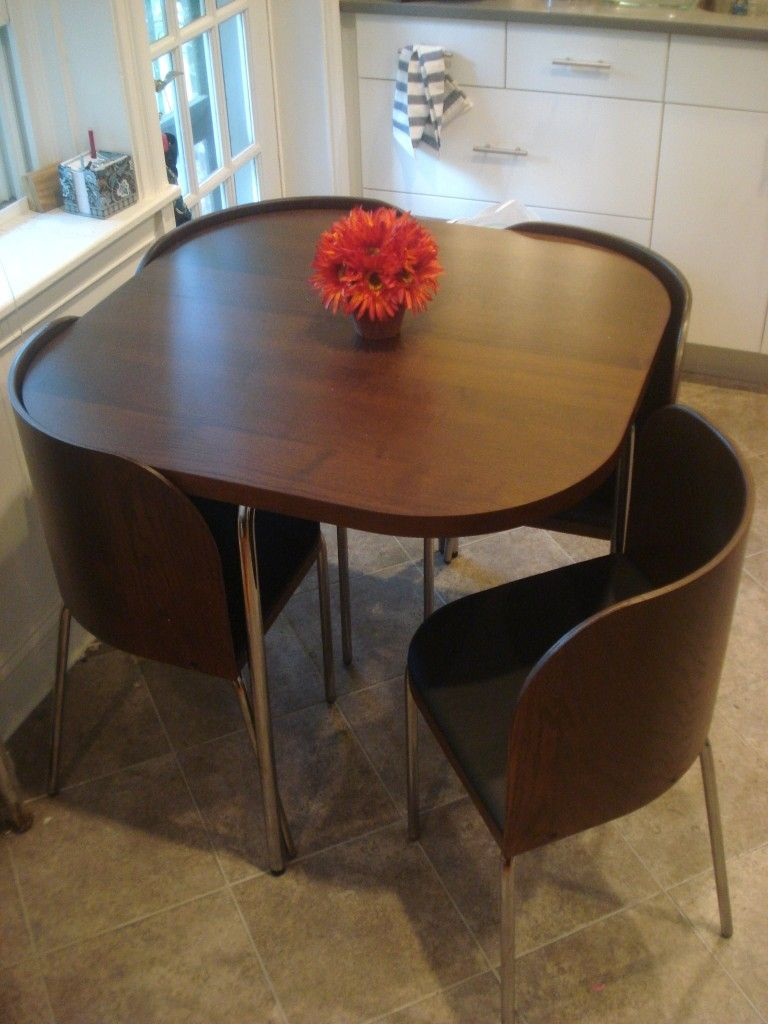 Space saving kitchen tables - A Table Where The Chairs Fit Perfectly Into Works Perfect For Small Spaces