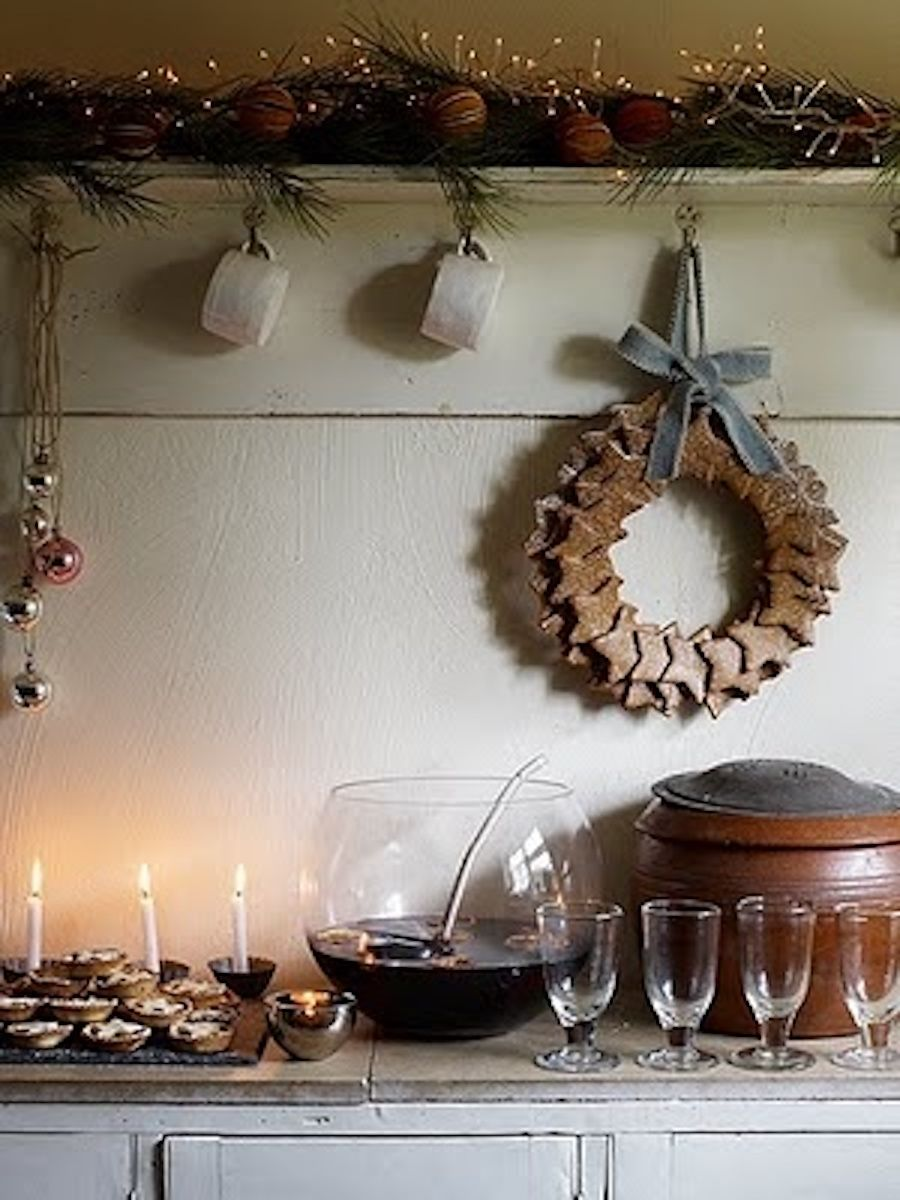 winter drinks station with mulled wine mince pies candles and