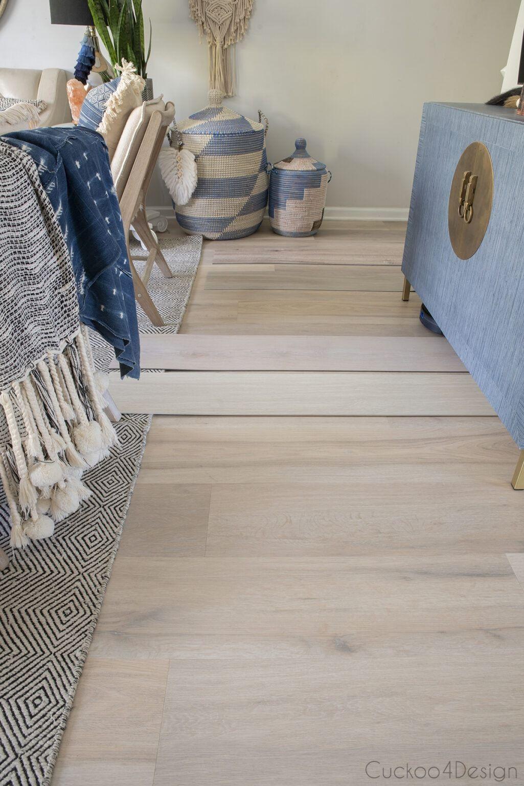 Comparing light colored wood vinyl plank flooring samples