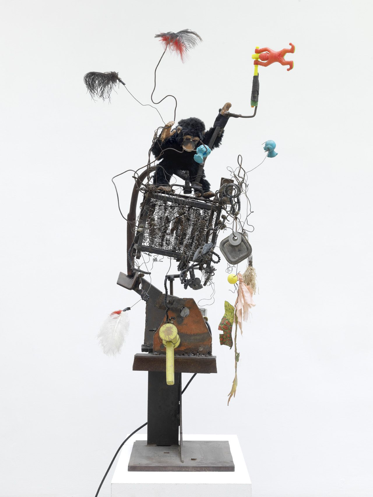 """Jean Tinguely, """"Wackel-Baluba"""" (1963), steel plate base, iron bars, springs and wires, plastic toys, feathers, toy monkey, electric motor, 49 5/8 x 15 3/4 x 25 1/4 in (courtesy NCAF et Galerie GP & N Vallois, Paris; photo by André Morin)"""