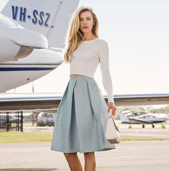 Cropped long sleeve white/cream top and pale blue midi-skirt ...