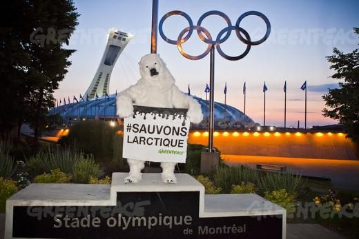 A polar bear stands by the Montreal Olympic Stadium to demand immediate global action to #SaveTheArctic. 06/21/2012  © Greenpeace
