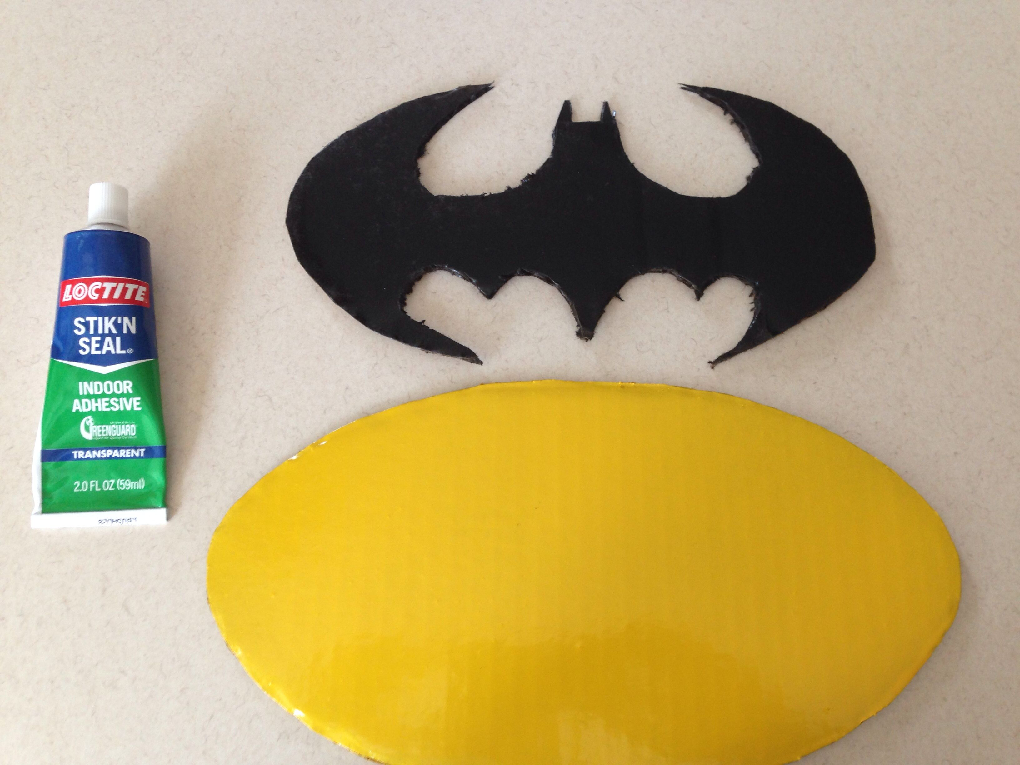 step 3.1 batman logo made from cardboard and painted. just sketched