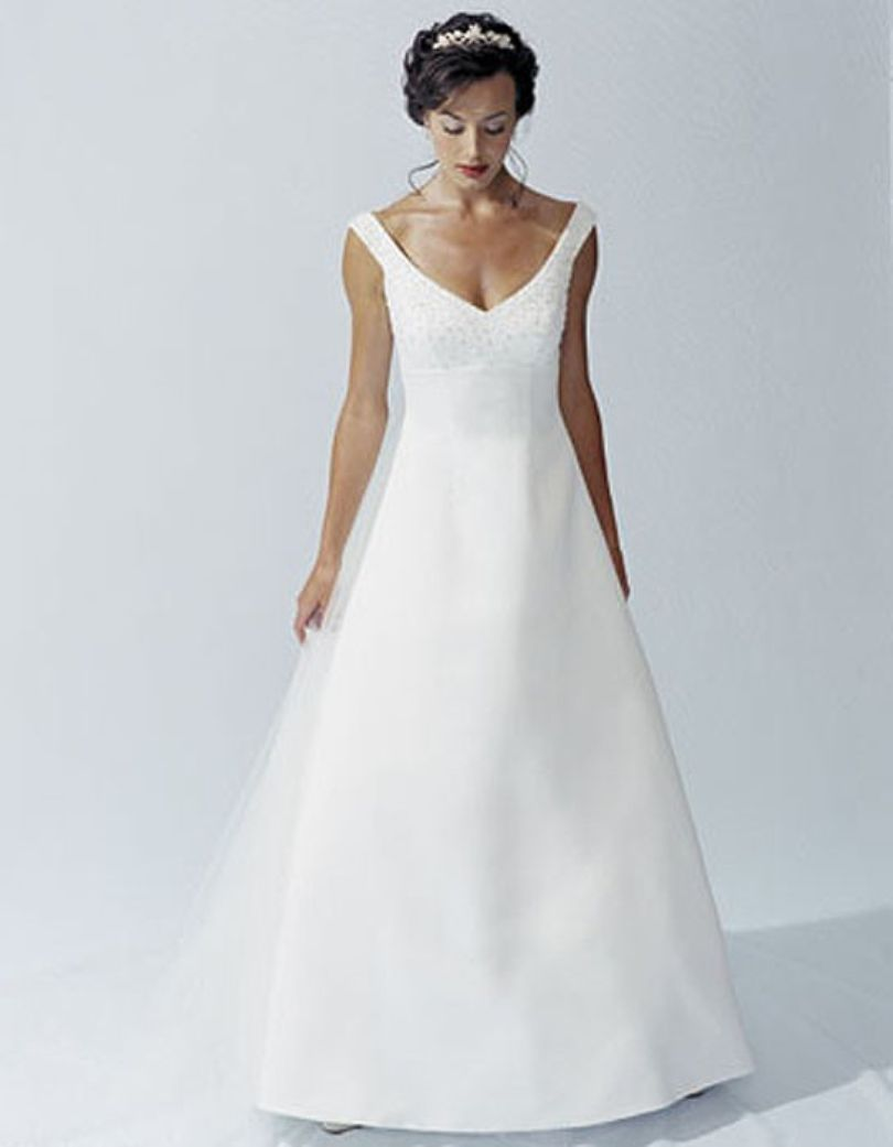 """This contemporary gown sparkles with thousands of bugle beads and sequins placed on the """"hug-the-shoulder"""" sleeves and bodice.  """"V"""" neckline and empire ..."""