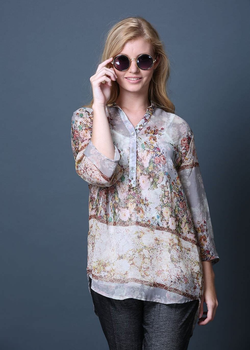 Yaara chiffon shirt in a brown-blue-yellow floral print. The Yaara shirt features a chinese collar, 3 buttons down the front, and a gentle pleat at the back. The back of this shirt is longer than the front, for a classy, flattering, and comfortable look