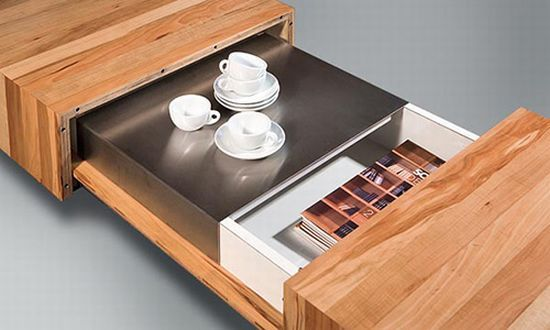 A coffee tables with hidden storage unit by Schulte Design