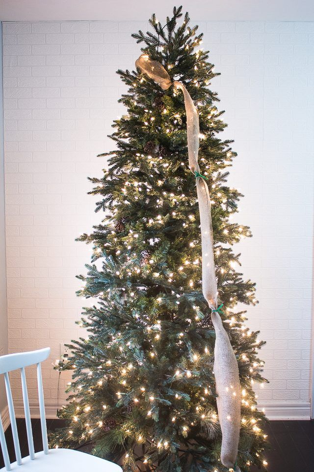 A ribbon is the perfect solution to concealing those bare spots in your Christmas  tree while also adding a touch of color and texture. - How To Put Ribbon Garland On A Christmas Tree Craft Ideas