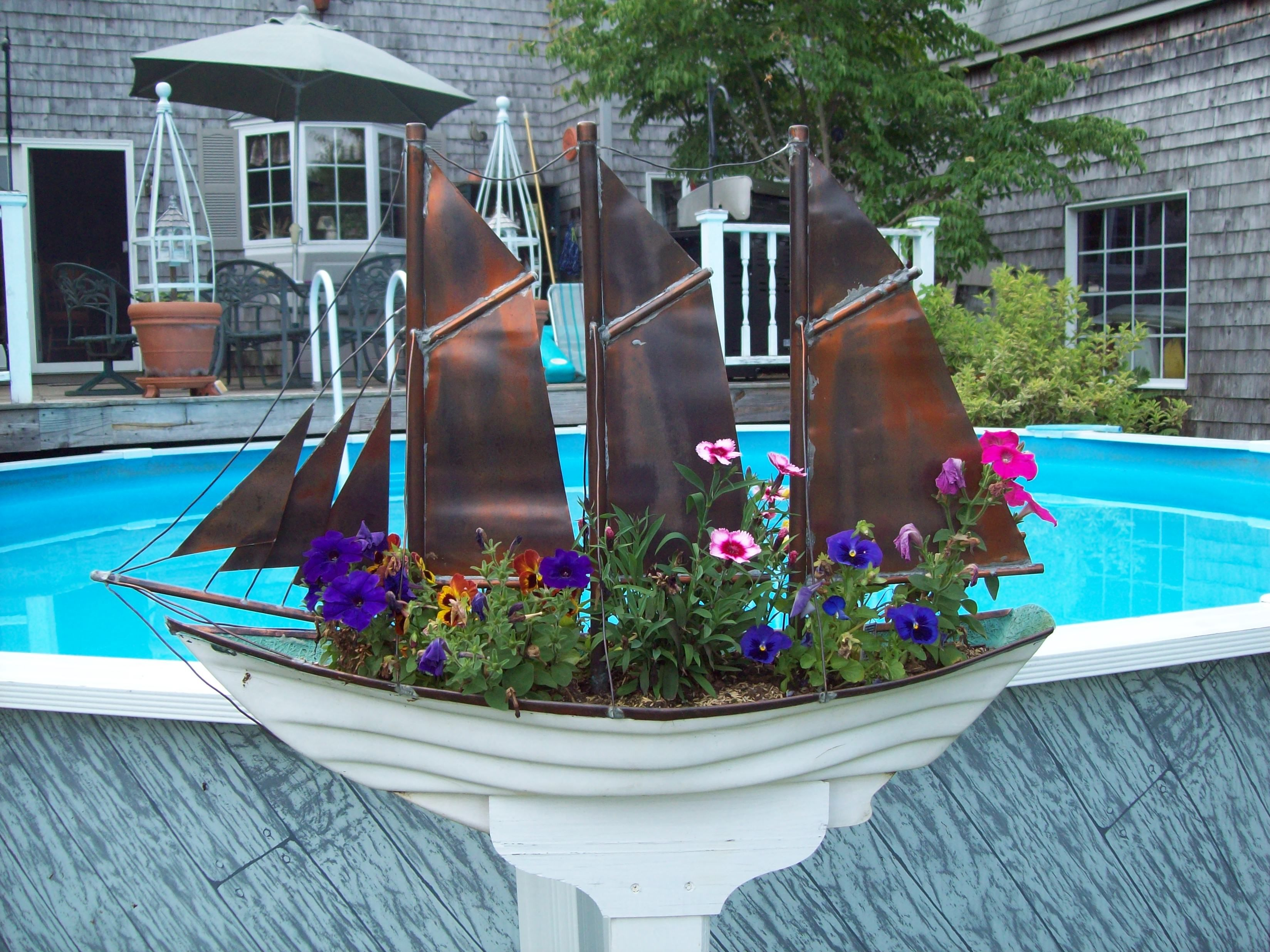 Turned a fiberglass boat shaped window box into a sailing for Boat mailbox