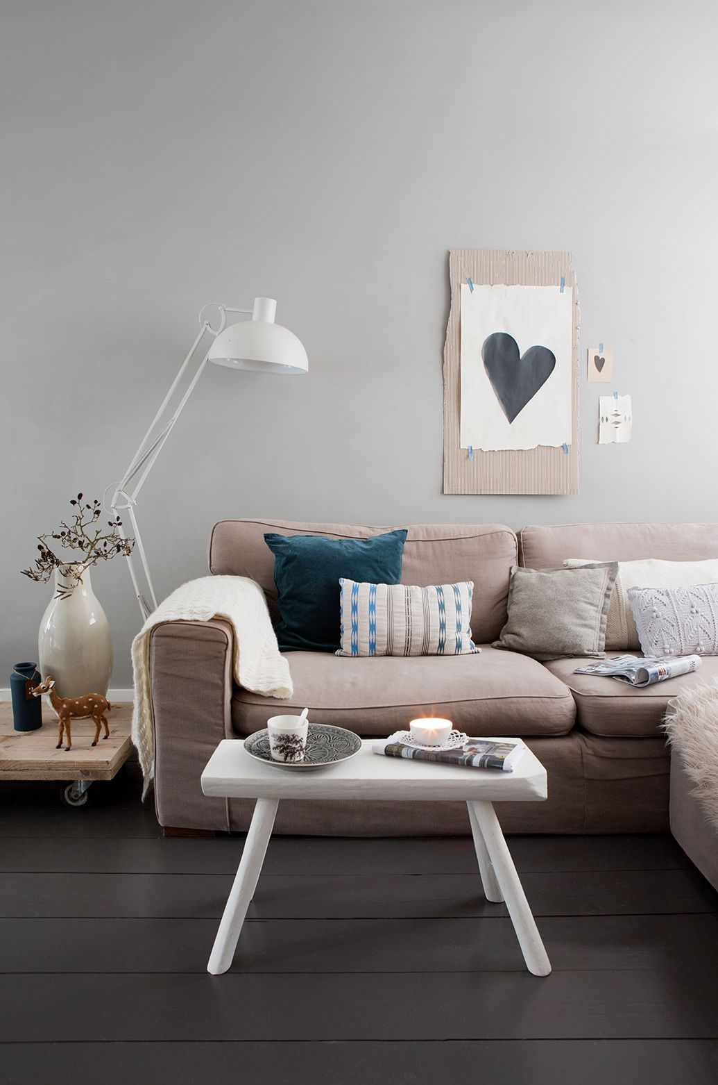 neutral colored living room and of course a heart on the wall