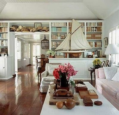 Love the built in bookcase.  I'm also finding I like dark floors and white cabinets/furniture.  Who would've thought?