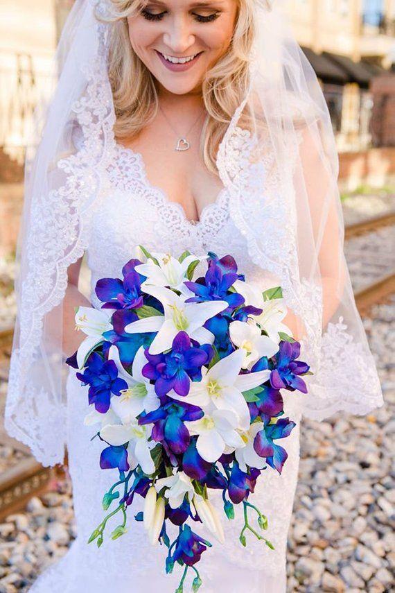 Brooklyn's Cascade Bridal Bouquet White Orchids White Smaller Tiger Lilies Blue Violet Dendrobium Orchids #bridalbouquetpurple
