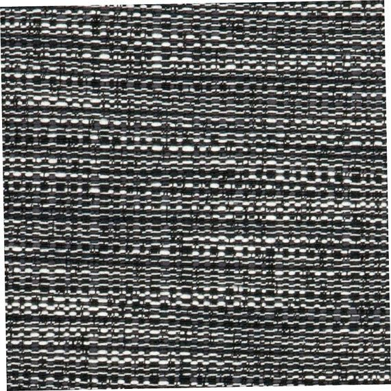 A Woven Tweed Upholstery Fabric In Black, White And Grey. This