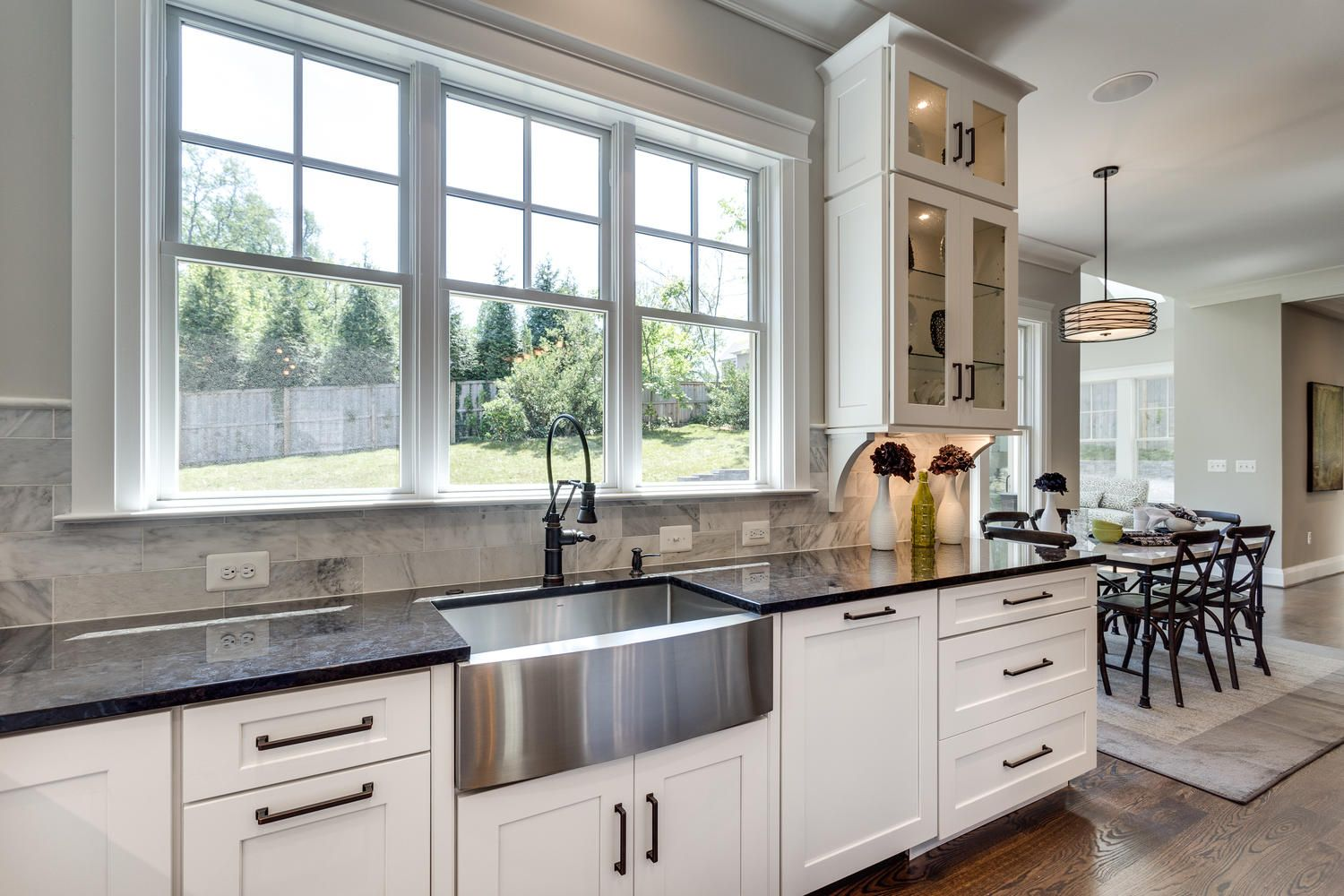 Apron Front Sink White Kitchen Cabinets Dark Granite Window Lighting New Home Construction Home Construction Custom Home Designs
