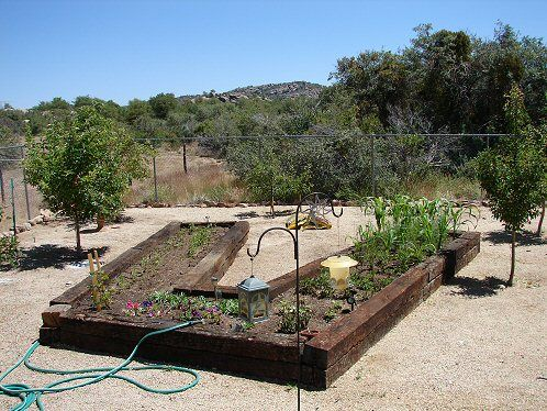 Raised Bed Garden Made Out Of Old Railroad Ties. Arizona Raised Bed  Vegetable Gardens For