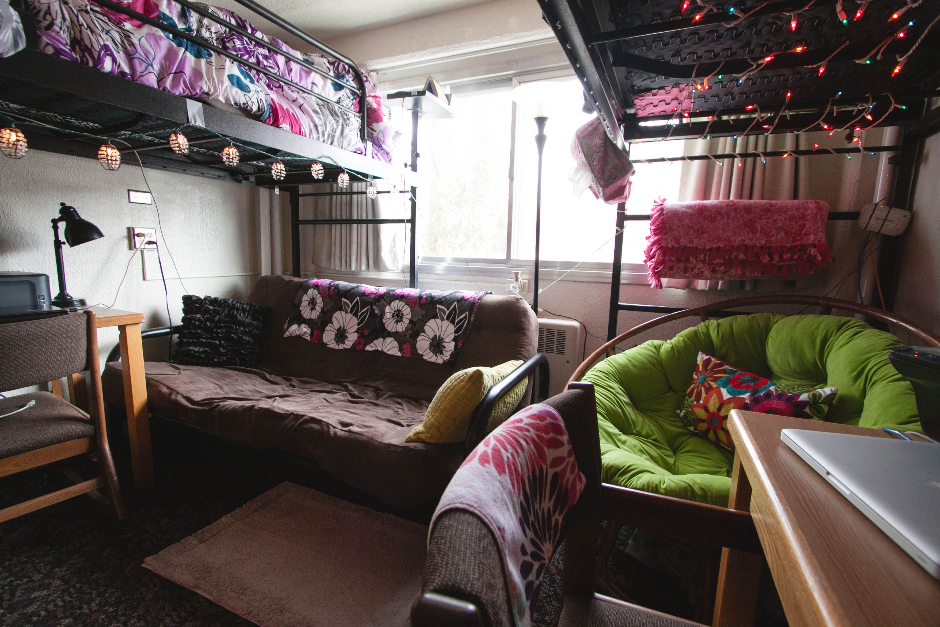 Two Lofted Beds Creates Room For A Lounge Area Underneath