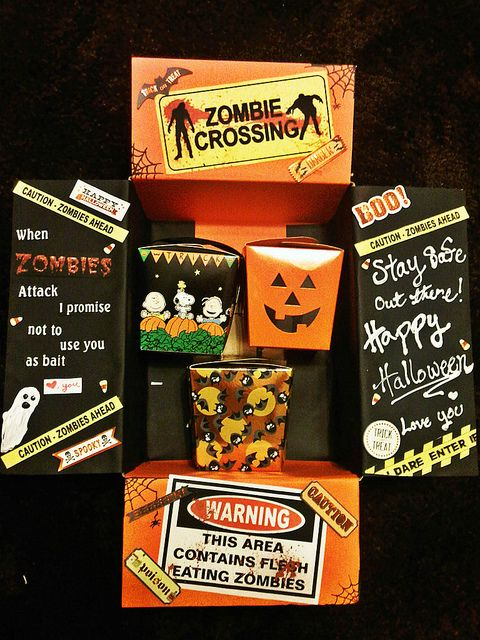 Just finished my Husbands Halloween care package :) construction paper, stickers, and goodie boxes from Michaels. I printed out the zombies sign and drew a couple of things