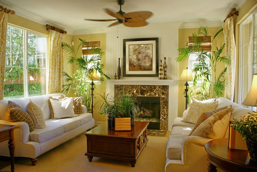 Bright Tropical Themed Living Room With Fan Yellow Living Room Yellow Walls Living Room Tropical Living Room