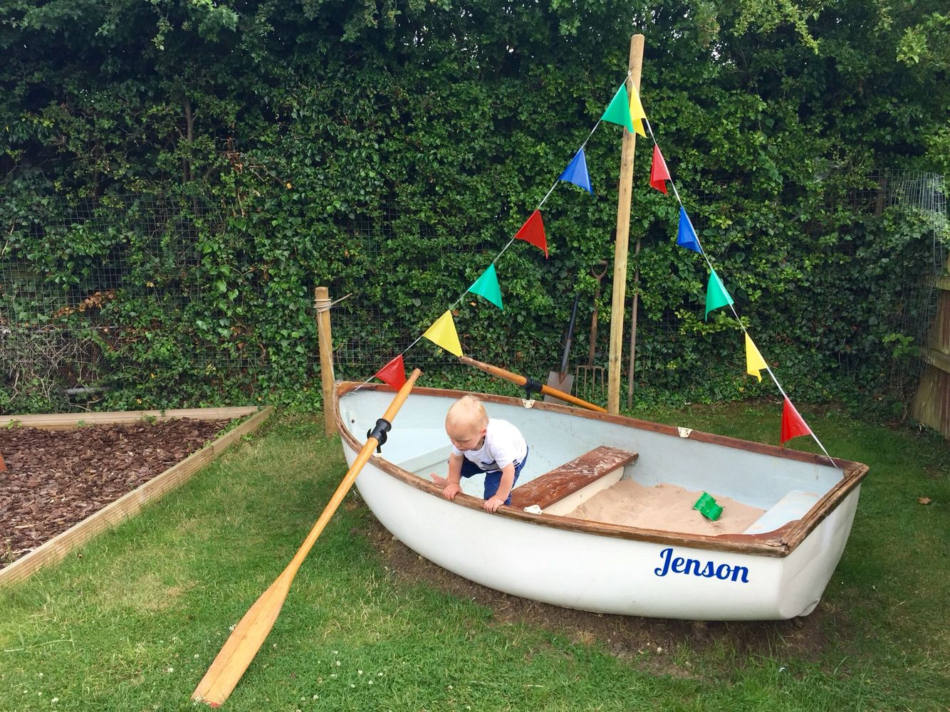 turned an old fiberglass sailing boat into a huge sandbox for the