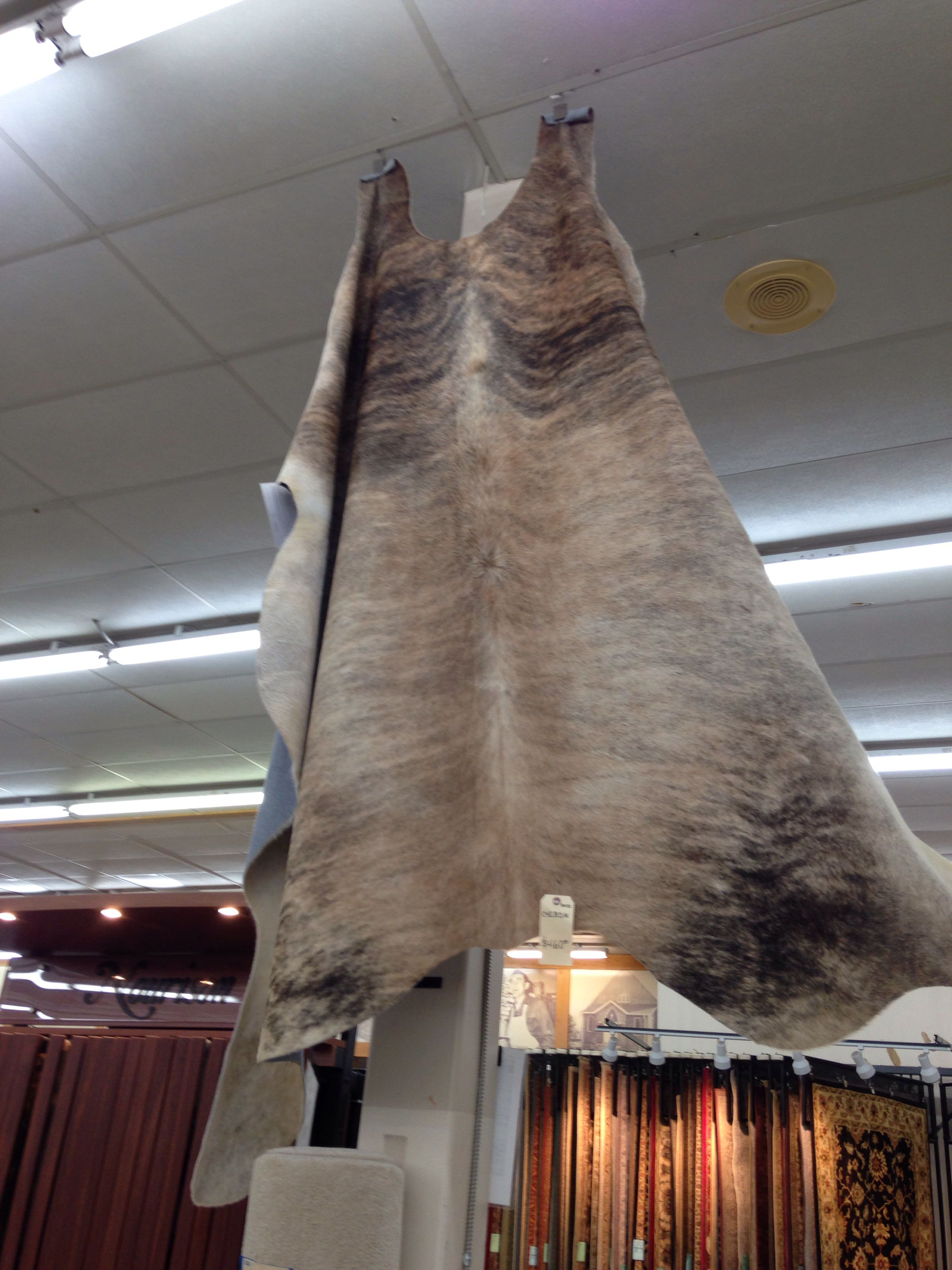 Cowhide rug - neutral for entryway..