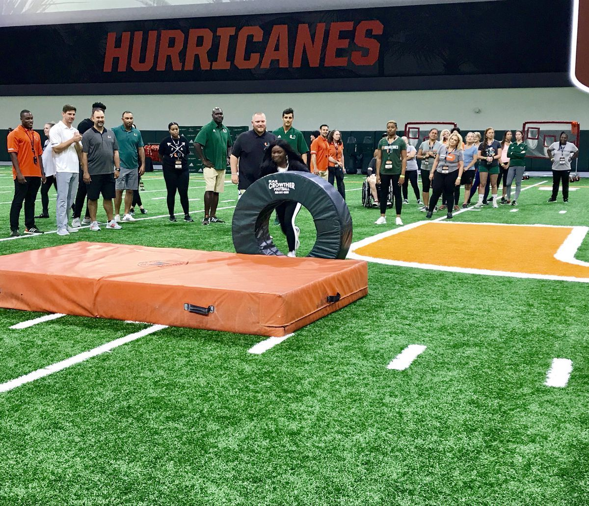 Manny diaz staff take select group of fans behind the