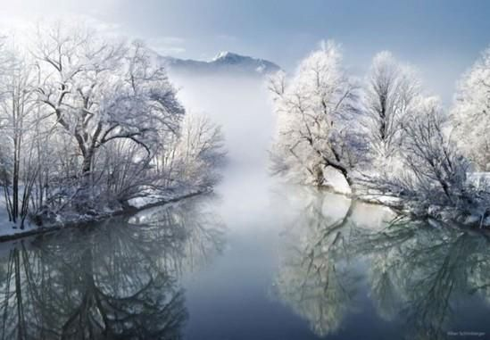 beautiful winter lake and snow with mist